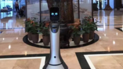 AI助力旅游产业:猎户星空智能服务机器人豹小秘获各国外宾点赞
